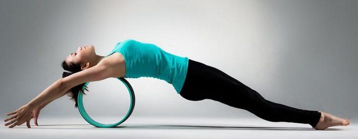 girl on yoga wheel